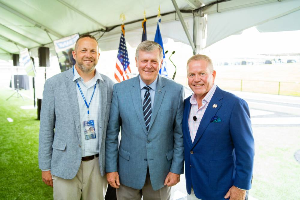 President Haas, Brian Kelly, and guest at the Jamie Hosford Football Center dedication.
